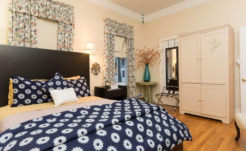 navy-blue-bed-with-white-flowers.jpg