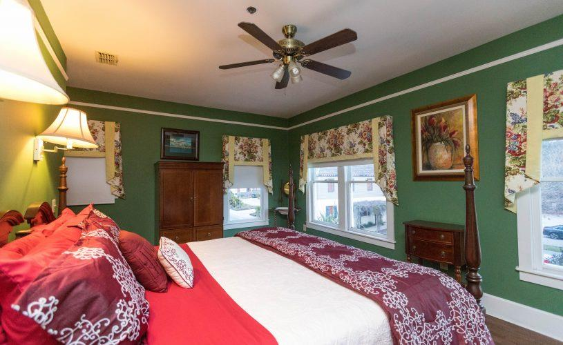 green-bedroom-with-red-bed.jpg